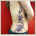 inkin - tatouage fleurs sur cotes - blood ink tattoo.png