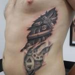 inkin - tatouage biomécanique engrenages sur cotes - cris tattoo 83.jpg