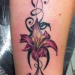 inkin - tatouage fleur sur jambe - adonis tattoo.JPG
