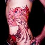inkin - tatouage poisson japonais sur cotes - body lines tattoo.jpg