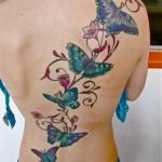 inkin - tatouage papillon dans le dos - ocuspicus tatouage.jpg