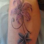 inkin-fleur-jambe-da-viken-tatouages-floral.jpg