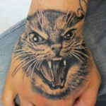 inkin - tatouage chat sur main - calavera tatouage.jpg