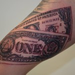 inkin - tatouage dollar sur le bras - news ink tattoo.jpg