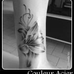 inkin - tatouage fleur sur bras - couleur acier.jpg