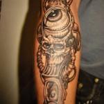 inkin - tatouage oeil et crane sur dos - crabtattoo.jpg