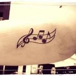 inKin-tatouage-partition-bras-INK N ROLL.jpg