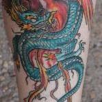 inkin - tatouage dragon et phénix sur mollet - collector tattoo.JPG