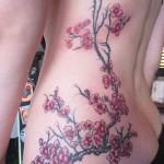 inkin - tatouage fleurs de cerisier sur côtes - a.raok tattoo.jpg