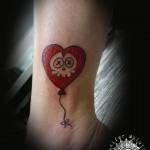 inkin - tatouage tête de mort ballon sur bras - abraxas beaubourg.jpg