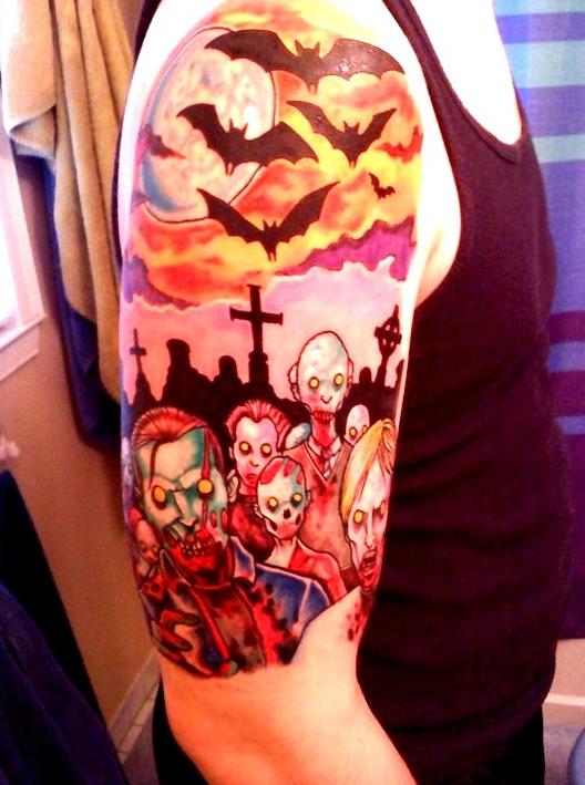 inkin - tatouage famille de zombies et de chauve souris sur épaule