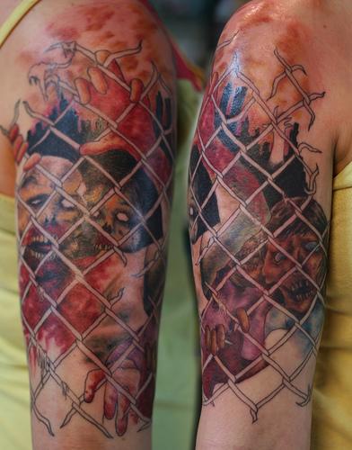 inkin - tatouage zombie derrière grillage sur épaule - par annie mess